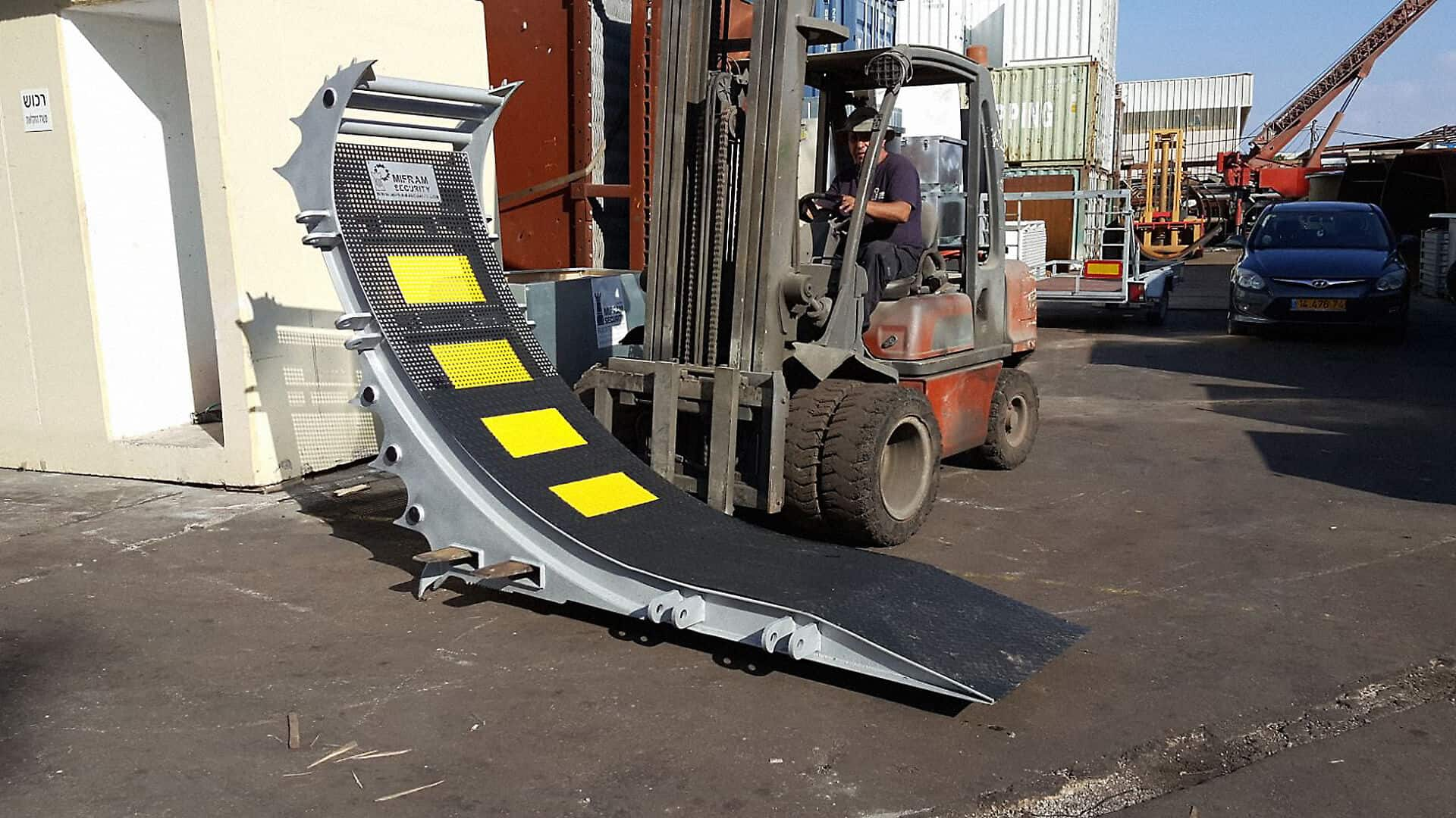 Moving a unit of the RMB truck barrier using a forklift