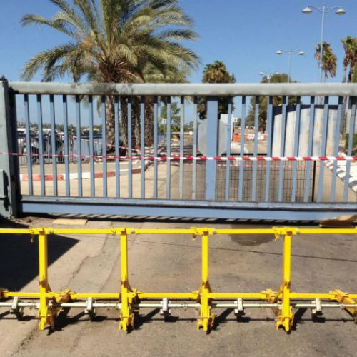 Vehicle barrier securing a gate