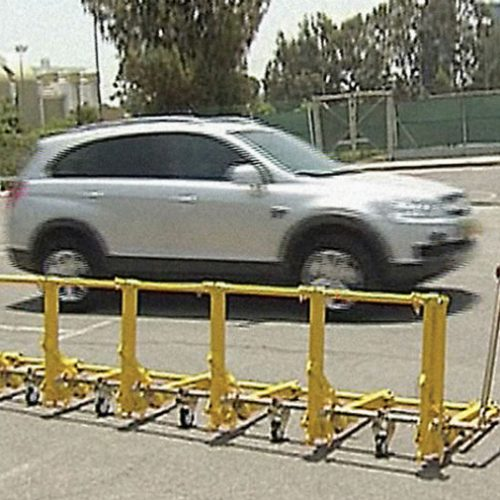The vehicle barrier used to secure a perimeter of an industrial zone