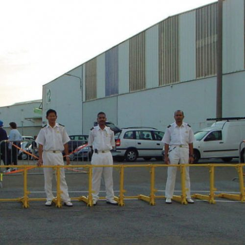 Sea port personnel using standing in front of a vehicle barrier