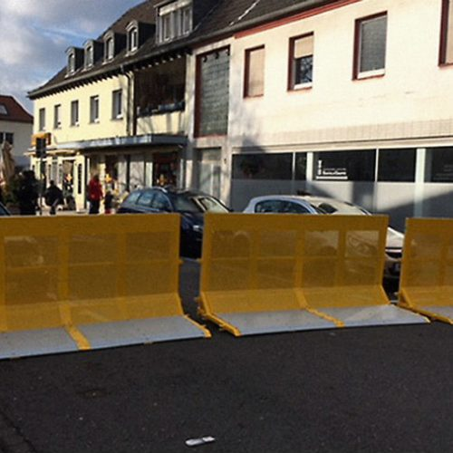 3 units of a vehicle barrier blocking the road
