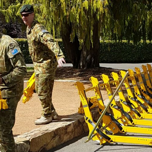 Soldiers deploying vehicle barrier units